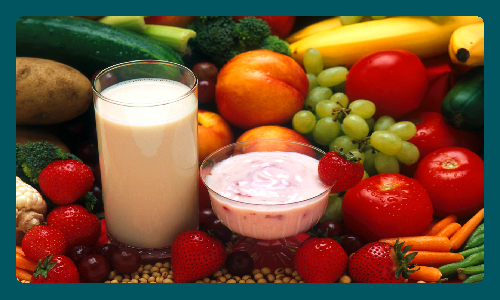 Photo of vegetables, fruit and a glass of milk